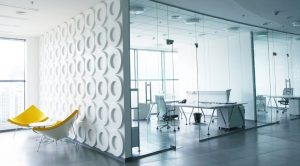 What are the uses and benefits of glass partitions?